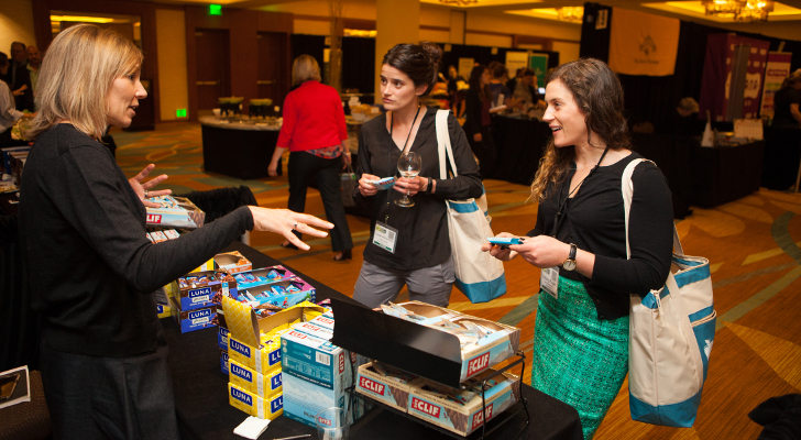 Laura Holtrop Kohl of Harmons Grocery (center) and Hannaford's Hillary Pride meet with Clif Bar's Tara Delloiacono