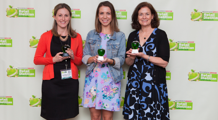Progressive Grocer Outstanding Innovation Award Winners Ashley Cully (left), Ravitz Family Markets, ShopRite of Marlton, Emily Parent (center) of Coborn's, with Progressive Grocer's Joan Driggs (right) with the award for Martin's Super Markets