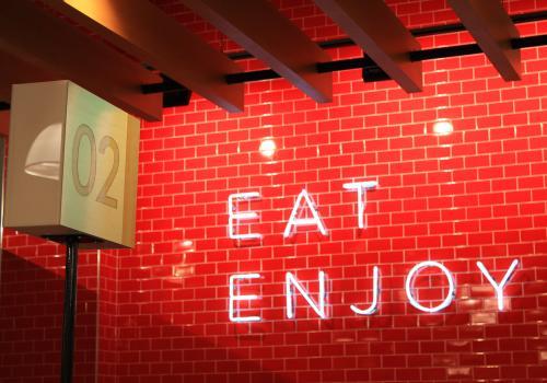 Roche Bros. at Arsenal Yards Eat Enjoy Sign