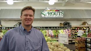 a man standing in front of a store